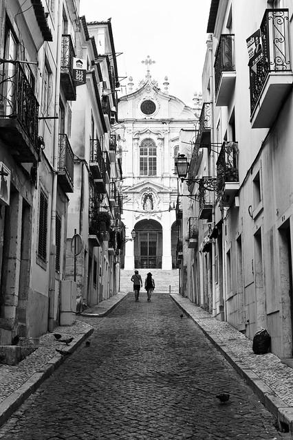 Tourists walk trough a typical Lisbon street (2019)