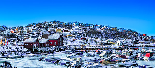 Boats frozen in ice at Narvik Marina and showing the landscape of Narvik, Norway-33a