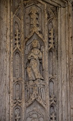 C15 south door: Instruments of the Passion, angel holding a cockerel