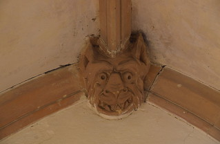 south porch boss: grinning devil