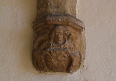 south porch corbel: angel with heraldic shield
