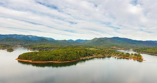 lake land landscape autumn sky clouds bank shore boat outdoor