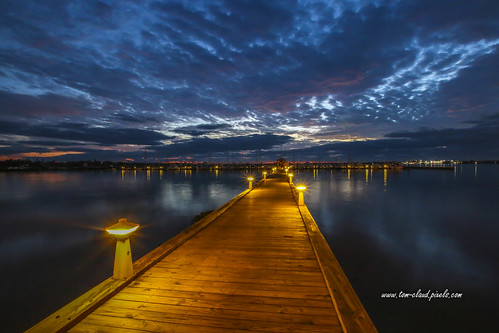 walkway boardwalk lights lighted marina boats docks morning dawn sunrise weather clouds cloudy water river saintlucieriver reflection reflect bridge rooseveltbridge stuart florida usa outdoors nature mothernature