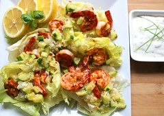 STIR-FRIED CHILI BLACK TIGERS WITH CUCUMBER SALSA ON ICEBERG HEARTS IN LIME VINAIGRETTE, TZATZIKI