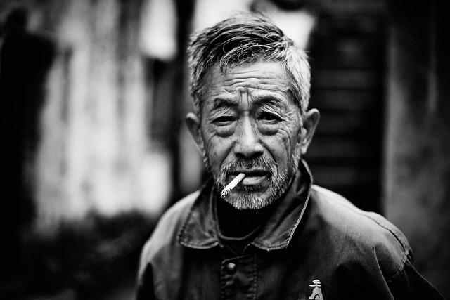 A portrait of old man with cigarette