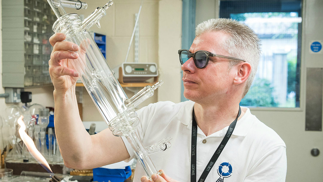 Phil holding up his prize-winning glassblowing piece.