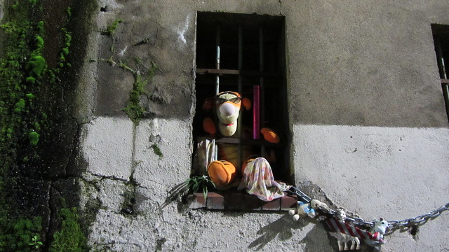 Art Pieces Spotted A Guitar And A Tiger Cuddly Toy protruding From Windows Of A Building In A Lane In Glasgow Scotland - 2 Of 2
