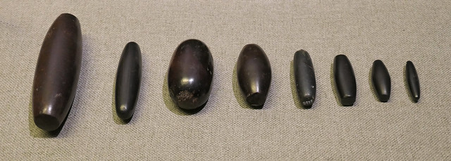 Examples of shekels, made of Hermatite - Near Eastern weights of the Late Bronze Age, 2000-1000 BC