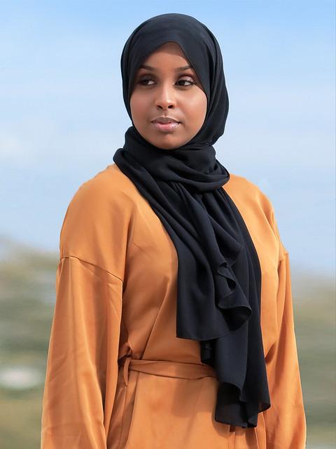 Beautiful muslim girl posing with hijab and yellow dress