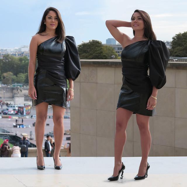 Spanish fashion model posing in black leather mini dress