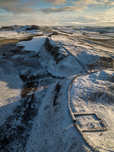 britain british england english greatbritain hadrianswall highshieldcrags milecastle39 northumberland oncebrewed romanbritain romanempire sycamoregap uk unitedkingdom aerialview birdseyeview countryside crag crags droneshot fort fromabove frozen hill hills landscape milecastle nature outdoors snow sycamoretree tree wall winter hexham