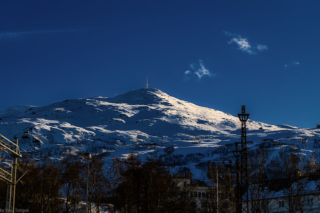 One of the many snow-covered peaks of mountains near Narvik, Norway-41a