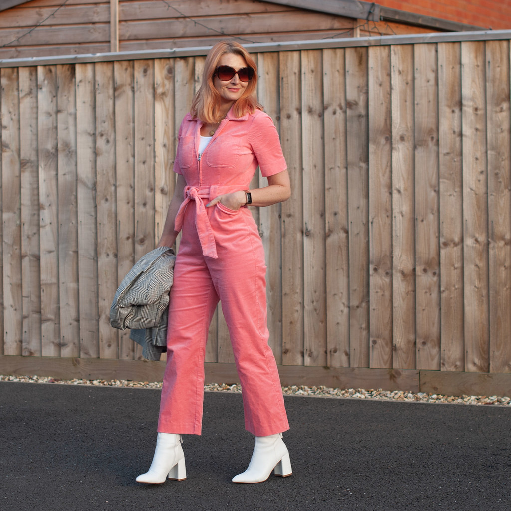 A Pink Corduroy Jumpsuit Styled With White \ 70s style \ white boots \ Prince of Wales check blazer \ gold layered necklaces | Not Dressed As Lamb, over 40 fashion and style blogger