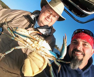 Photo of two men with a jumbo-sized Miles River crab