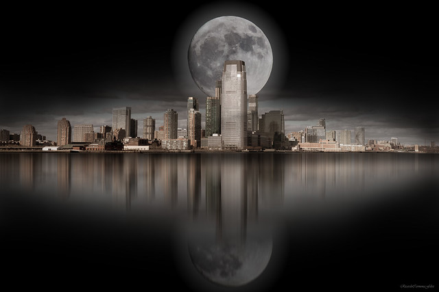 The moon over the city in the dark