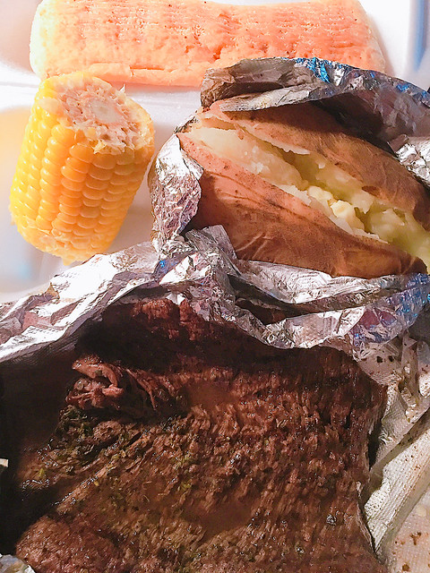 Took a chance, was pleasantly surprised. Med rare skirt steak, corn, baked potato, garlic bread. Au jus too. I just added crumbled bleu cheese.