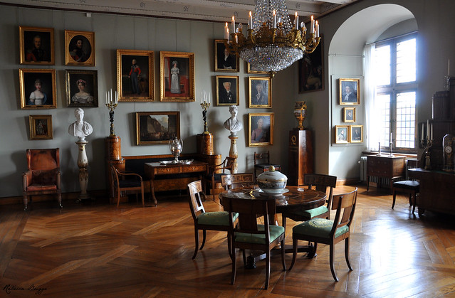 Castle interior with portraits