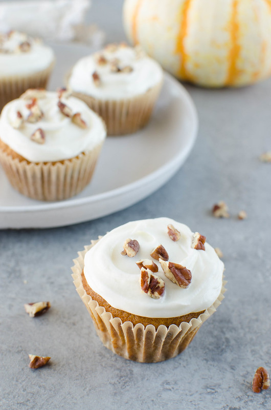 Pumpkin Spice Cupcakes - pumpkin cupcakes with pecans and raisins and topped with cream cheese frosting!