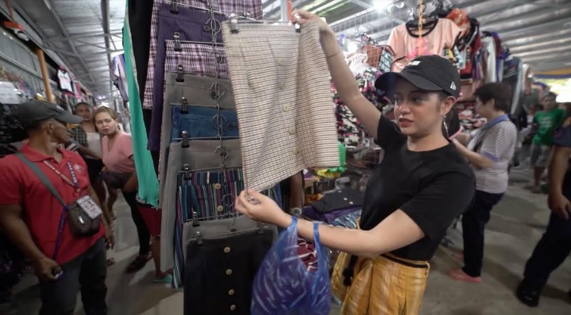 Sue shops in a tiangge in Rizal