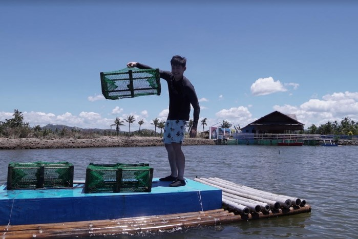 Robi catches crabs in Capiz