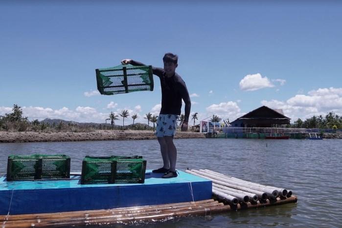 Robi catches crabs in Capiz