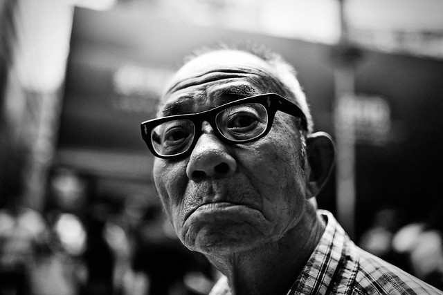 An old man with glasses