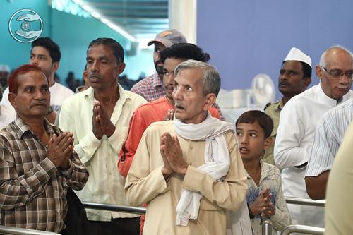 Devotee seeking blessings from Holy feet