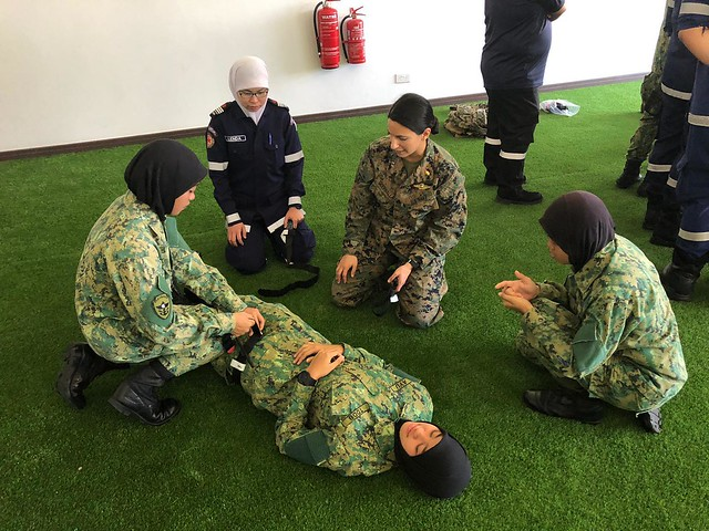 Medical personnel from Marine and Royal Brunei Armed Forces conduct tactical combat casualty care training.
