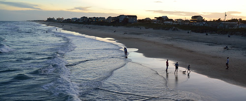 surf dusk atlantic beachgoers stroll wade dog sunset panorama nikon d600 fullframe boguebanks bogueinletpier coast beach silhoutte