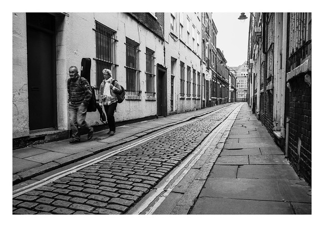 FILM - Couple with a guitar on a cobbled street