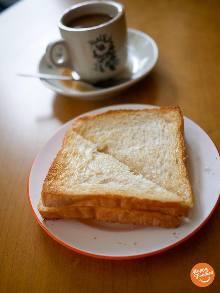 Kaya toast served alongside the buttered coffee