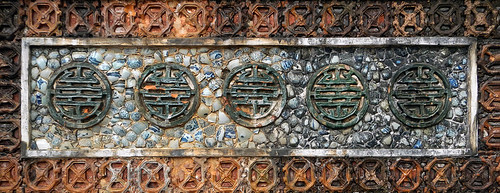 Decorative ceramic mosaic wall in TuDuc's royal tomb in Hue, Vietnam