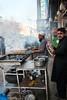 Kebab restaurant in a bazaar, Peshawar, Pakistan ペシャワール、バザールの道端でケバブを焼いているレストランの店先 by travelingmipo