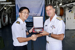 Adm. John C. Aquilino receives a memento from Rear Adm. Aaron Beng, fleet commander of the Republic of Singapore Navy (RSN), during a visit to the stealth frigate RSS Stalwart (72) at Changi Naval Base, Oct. 25. (U.S. Navy photo)