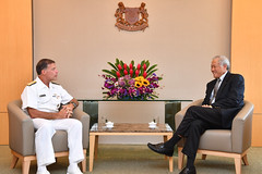 Adm. John C. Aquilino calls on Minister for Defence Dr. Ng Eng Hen, Oct. 25. (Singapore MINDEF photo)