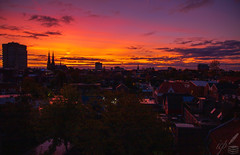 Dawn breaks over Eindhoven, the Netherlands. As the sun is about to rise above the skyline, the cloud-laden skies are rimmed with spectacular colours of splendor and magnificence.   This new day is one of the Dutch Design Week 2019 that is well underway in Eindhoven.