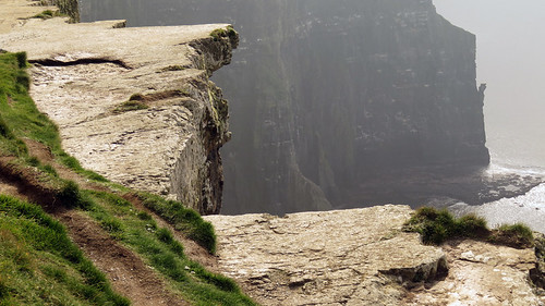 Close-up of the jagged undercut edge at the Cliffs of Moher in Ireland