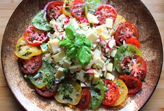 CHEESE & TOMATO SALAD – HEIRLOOM TOMATOES, GOUDA, RADISH, ONION, BASIL AND SCALLION IN HERB VINAIGRETTE