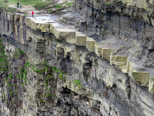 Long view of the jagged undercut edge at the Cliffs of Moher in Ireland