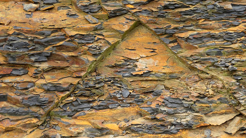Triangle of rusty slate at the Cliffs of Moher in Ireland