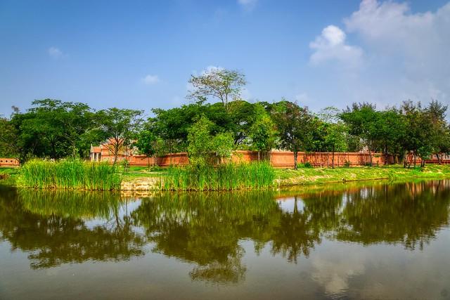 Lake with reflections in Muang Boran (Ancient City) in Samut Phrakan, Thailand