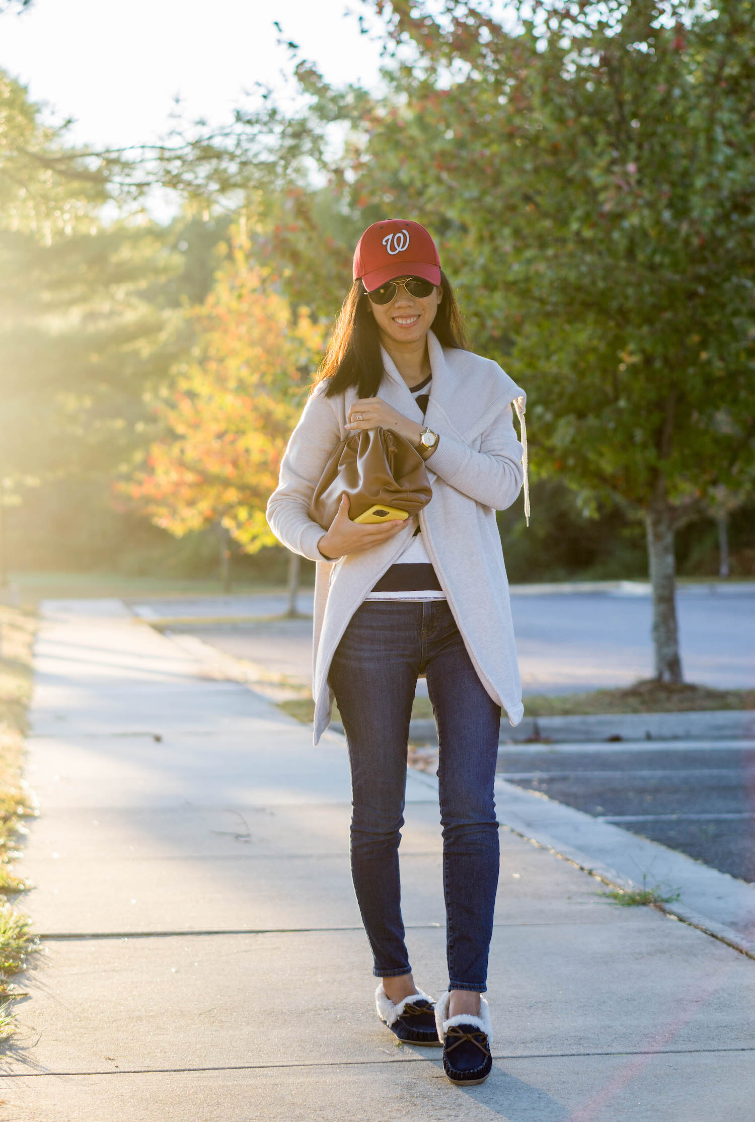 "Washington Nationals cap, Zella Nola wrap sweatshirt, Gap rugby shirt in navy stripes, J.Crew 8"" toothpick jean in Vista wash, Looks Like Summer Claudette leather crossbody bag, J.Crew Factory suede shearling moccasin slippers, Tory Burch Whitney watch"