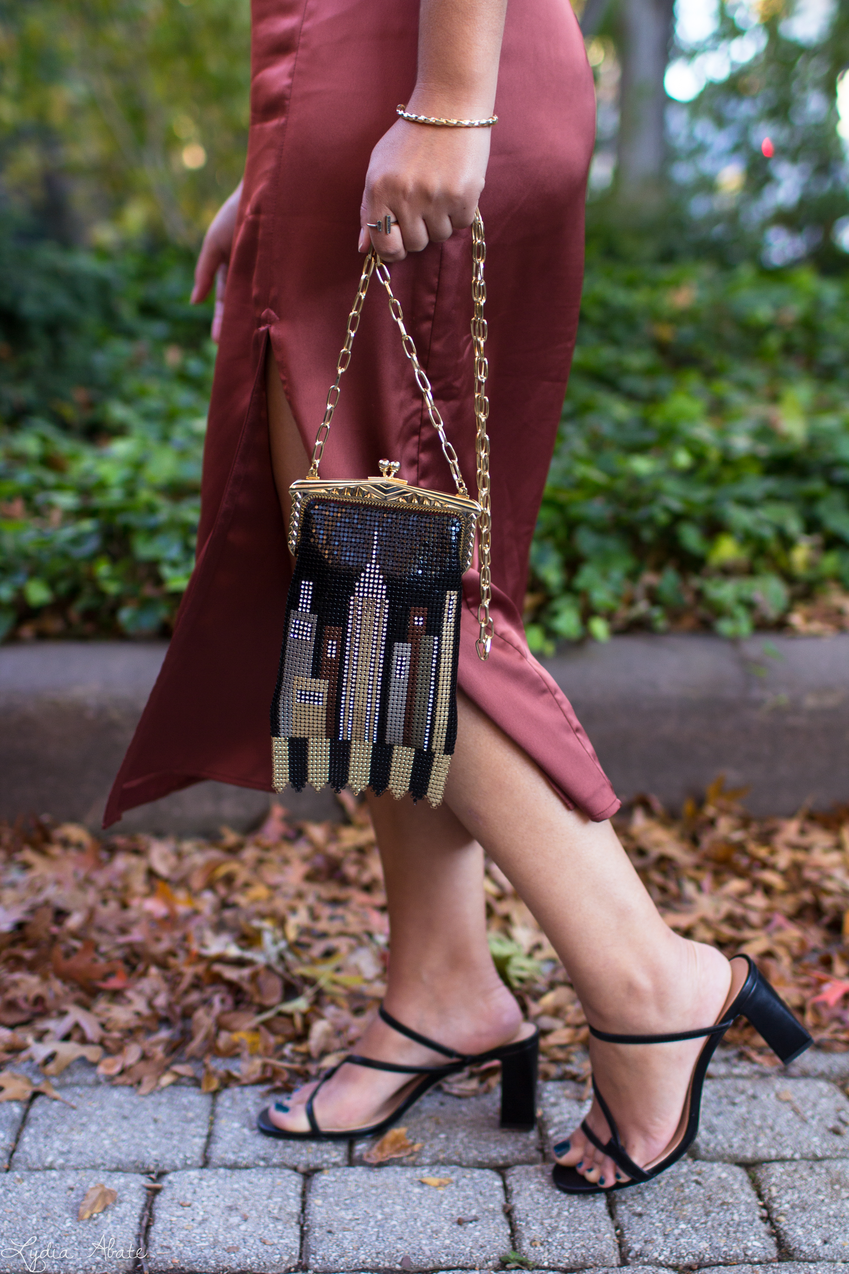 rust midi skirt, black off the shoulder top, leather jacket, skyline clutch-11.jpg