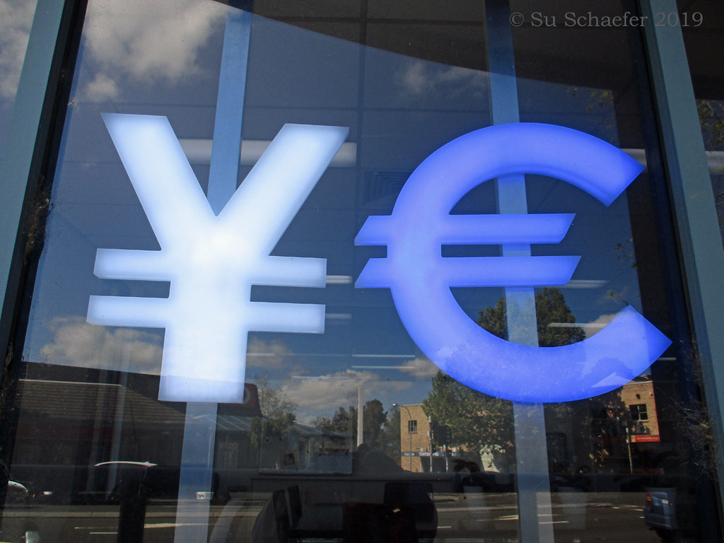 Seen on the street: Yen, Euro, in window with reflection