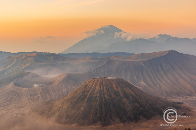 Mount Bromo, Batok and Semeru at sunrise on a windy, dusty morning