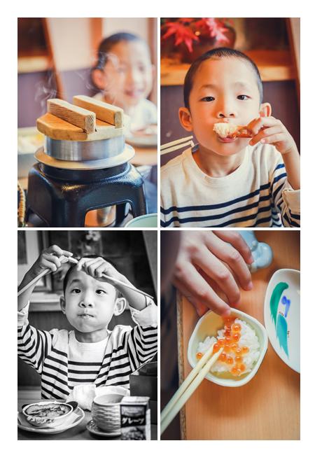 かにやいくらなど海産物を食べる男の子