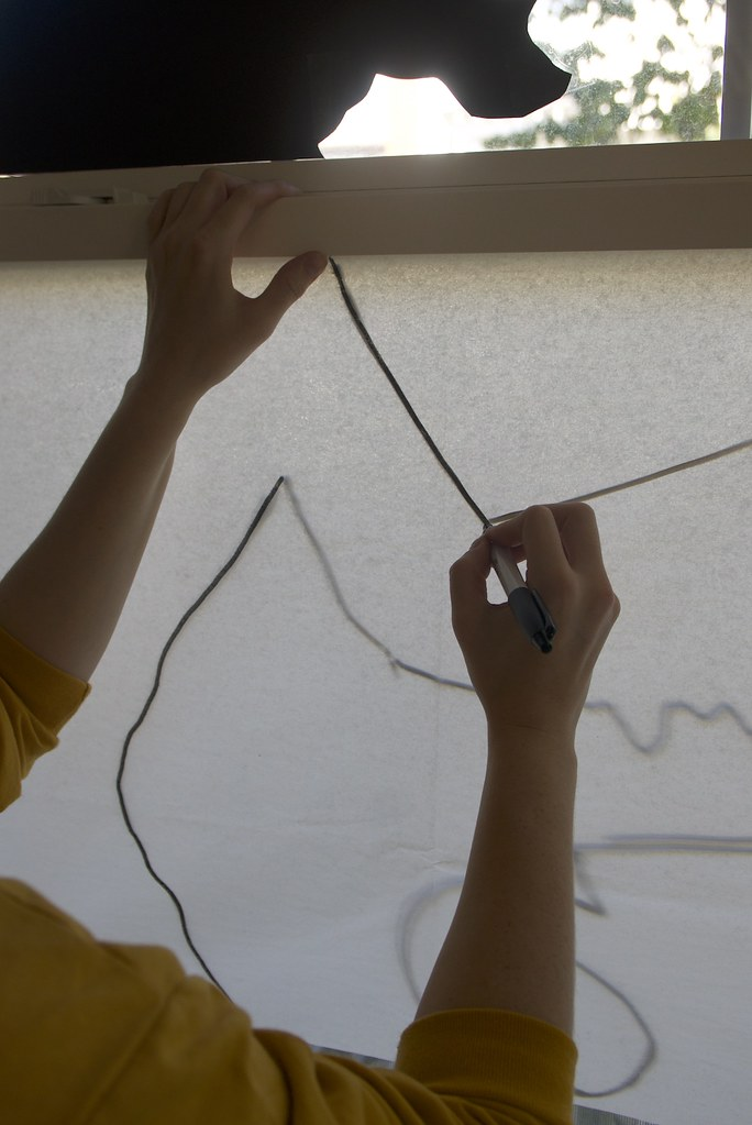Drawing the Halloween decoration onto tissue paper