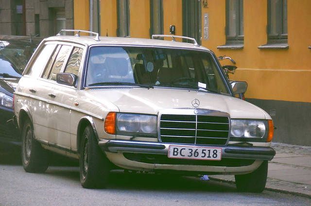 1983 Mercedes 230TE BC36518 wears a parking ticket on the roads of Denmark