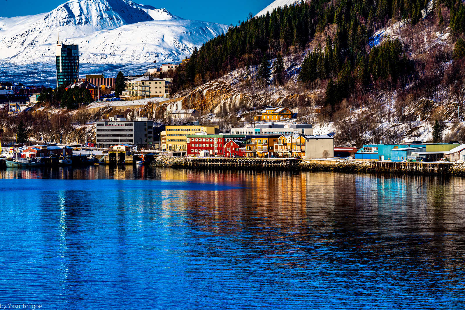 Beautiful reflections of buildings along the harbor of Narvik, Norway-62a