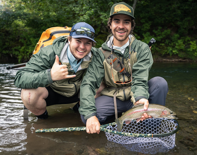 Dan Eiden and Theodore Benjovsky on a small river in the Olympic National Forest
